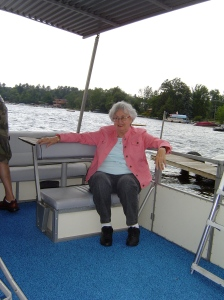 Mom enjoying the breeze on the pontoon boat.