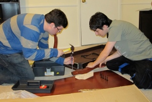 Cousins putting together a coffee table.