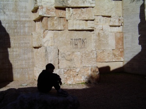 My son thinking in the map of the communities destroyed at Yad V Shem.