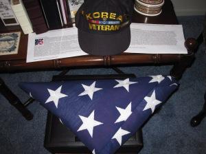 The flag from Dad's funeral.  His favorite Korea Veteran cap.
