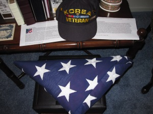 The flag from Dad's funeral.  His favorite Korea Veteran cap.