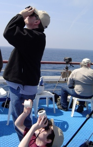 My husband and son watching the start of an eclipse from a cruise ship near Greece.