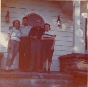 My parents and grandparents in front of the home in 1962.  My siblings and I now own it.