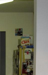 Entenmann's Crumb Cake hidden on top of the refrigerator.