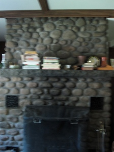 The fireplace in the center of the living room.