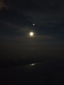 The moon from our plane window.  It was supposed to be daylight when we arrived.