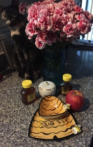 Honey, apples, serving dishes, flowers and my kitten make the holiday sweet and happy.