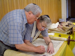 At Temple Israel in 2006. My Dad is with a scribe as they work on repairing older Torah scrolls.