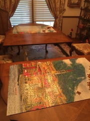 We divided the puzzle, put in the boards and then covered it!